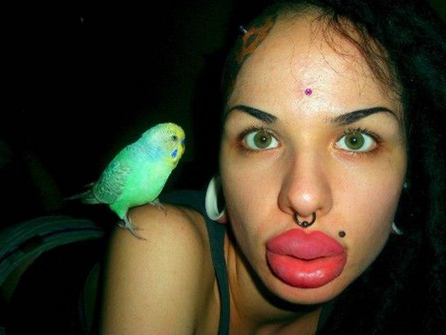 Самые большие губы в мире у Кристины Рэй